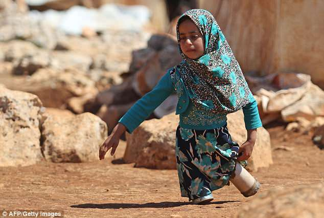 Maya, pictured, and her father Mohammed both fled Aleppo and are now in a displacement camp in Idlib