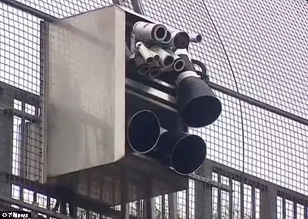 Cameras which have the ability to detect if motorists are using their mobile phones while driving have been set-up above one of Sydney's busiest roads in a world-first trial
