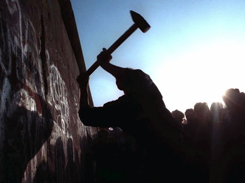 A man hammers away at the Berlin Wall Nov. 12, 1989, as the border barrier between East and West Germany was torn down after 28 years, symbolically ending the Cold War.
